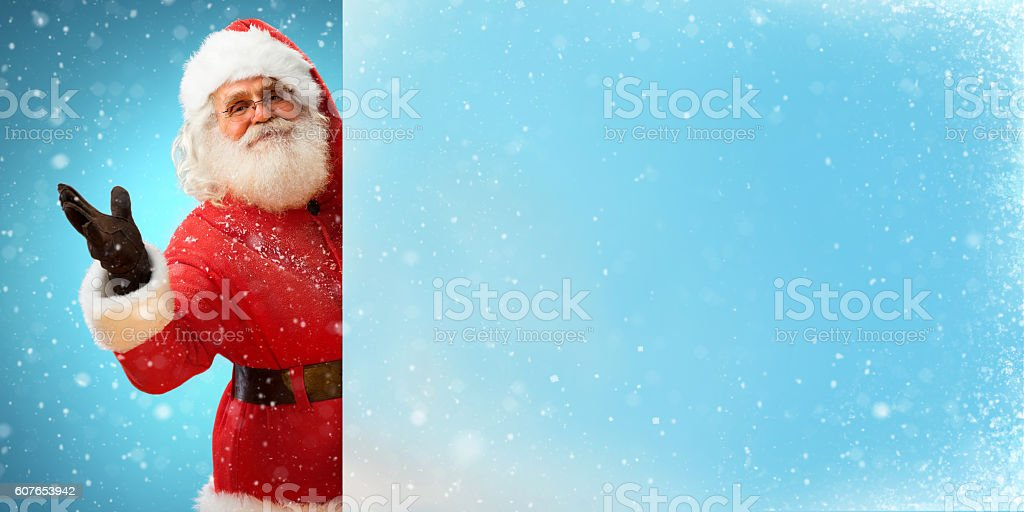 Jolly Santa Claus holding banner stock photo