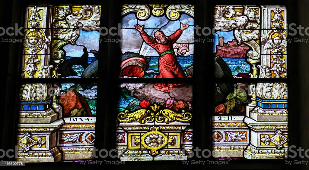Jonah and the Whale - Stained Glass window stock photo