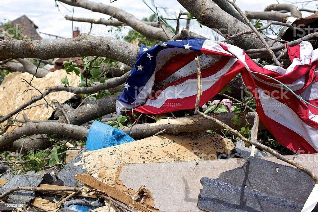 Joplin Missouri deadly F5 Tornado debris piled and American Flag stock photo