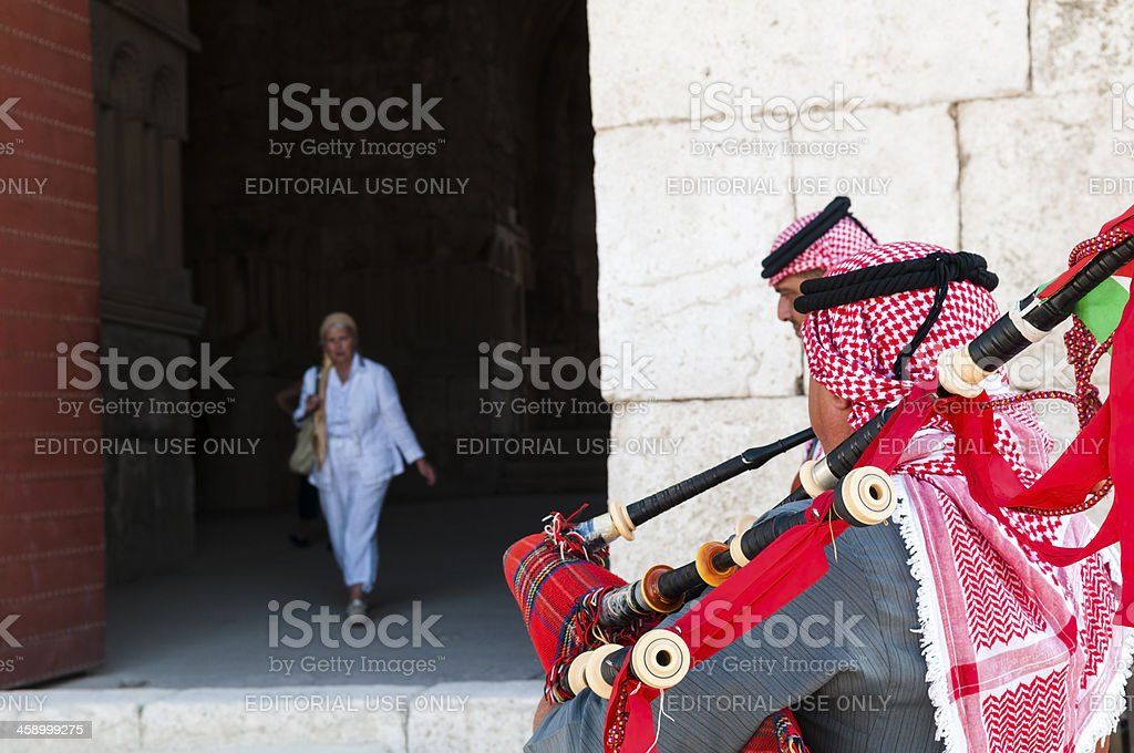 Jordanian bagpipers and tourist in Amman royalty-free stock photo