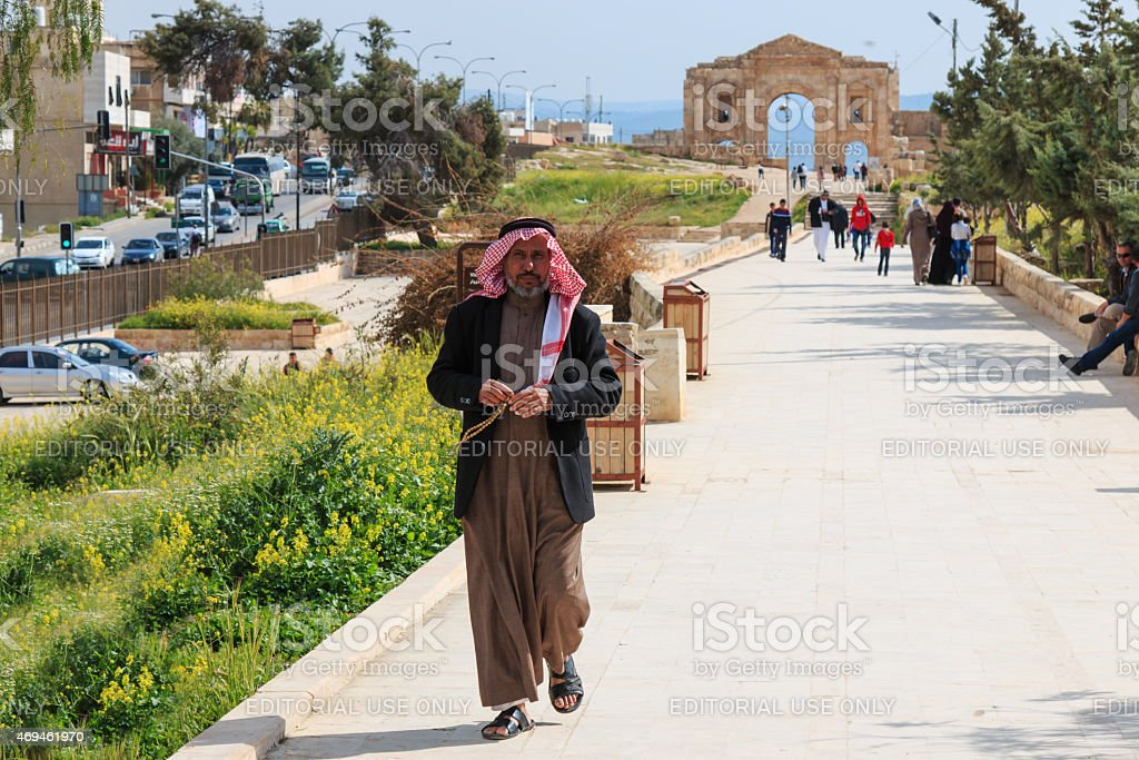 Jordanian man walking in Jerash stock photo