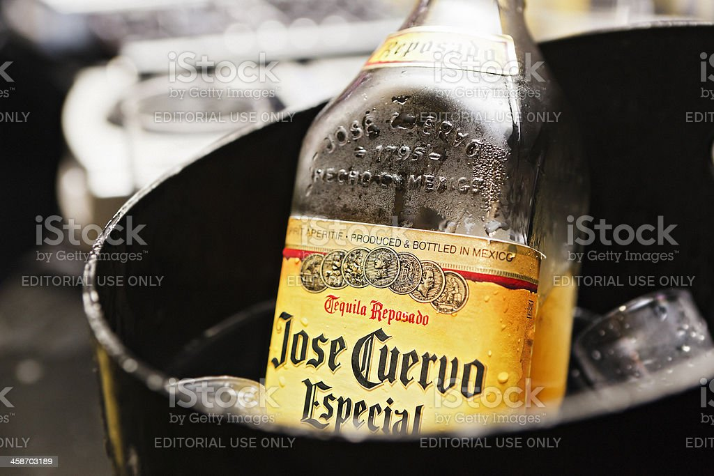 Jose Cuervo Especial tequila chilling in ice bucket stock photo