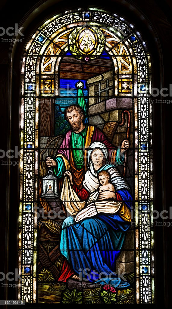 Joseph, Mary, and baby Jesus in stained glass stock photo