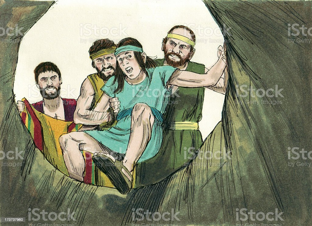Joseph's Brothers Place Him in Pit stock photo