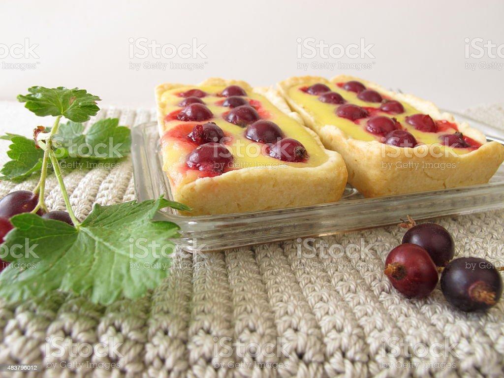 Jostaberry tartlet cake stock photo