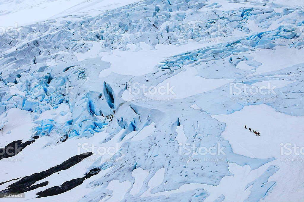 Jostedalsbreen: mountaineers walking on Briksdal Glacier  - Jostedal, Norway, Scandinavia stock photo