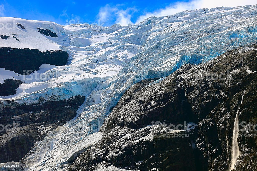 Jostedalsbreen: sunny Briksdal Glacier and cascade - Jostedal, Norway, Scandinavia stock photo