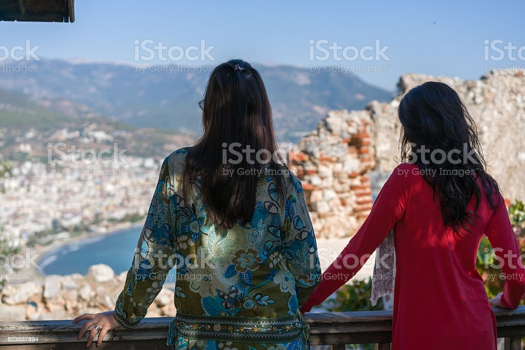 joung womens Looking at the view from the balcony stock photo