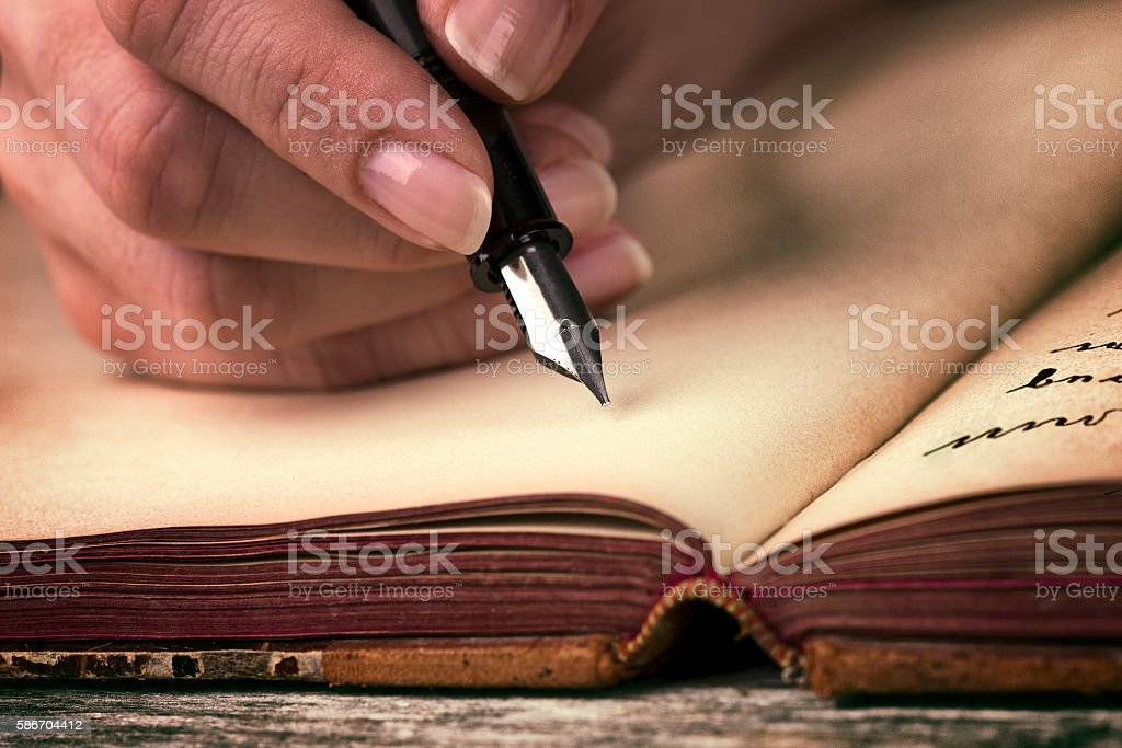 Journal writing stock photo