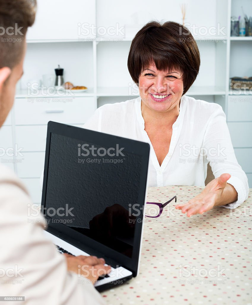 Journalist communicates with the wealthy woman stock photo
