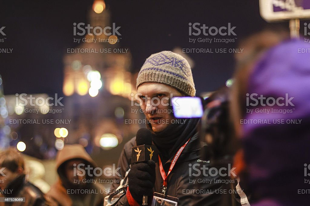 Journalist makes report with protesters. stock photo