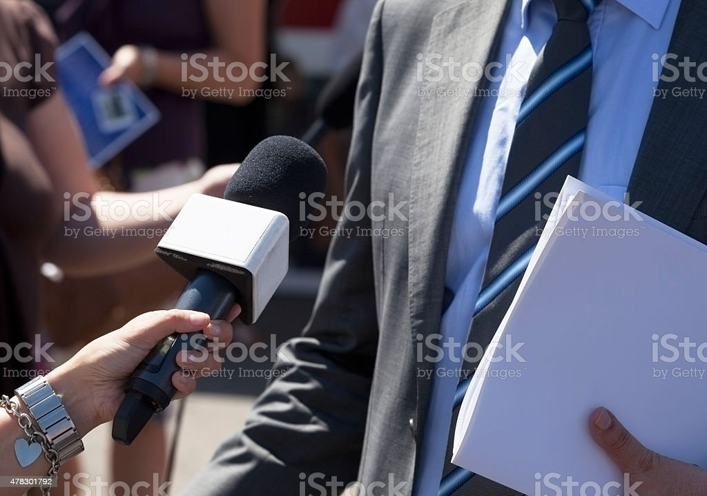 Journalist making media interview with businessman stock photo