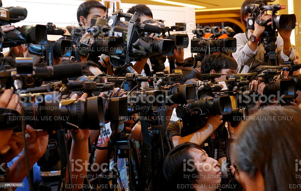 Journalists lined up covering public event stock photo