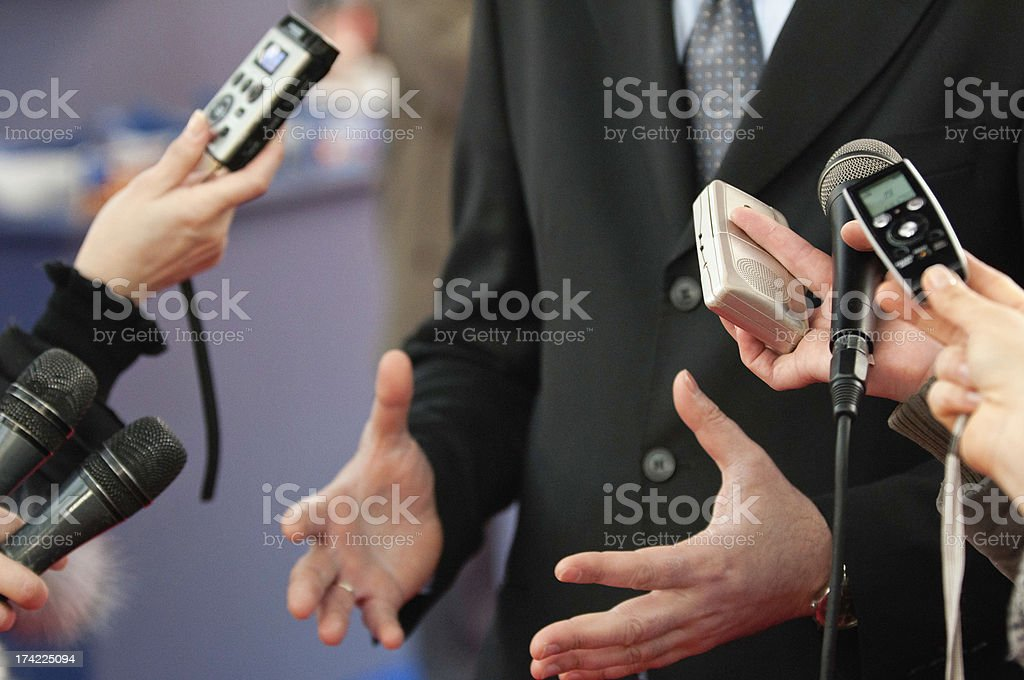 Journalists making media interview royalty-free stock photo