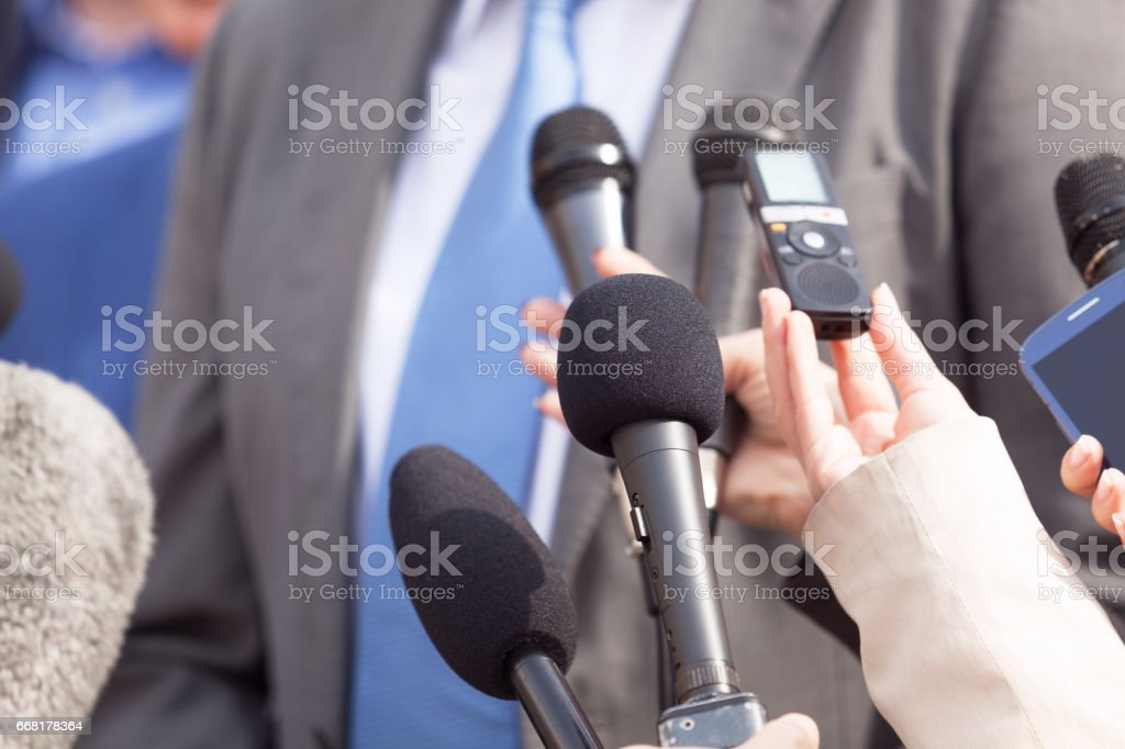 Journalists making media interview with businessperson or politician. Press conference. Journalism. stock photo