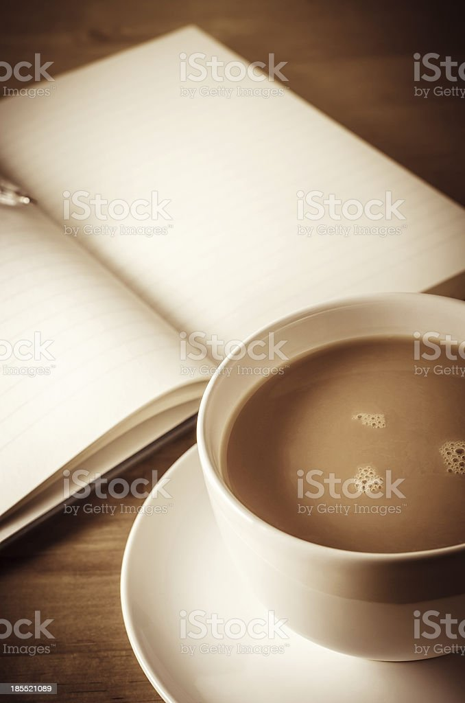 Journalling with Cup of Tea stock photo