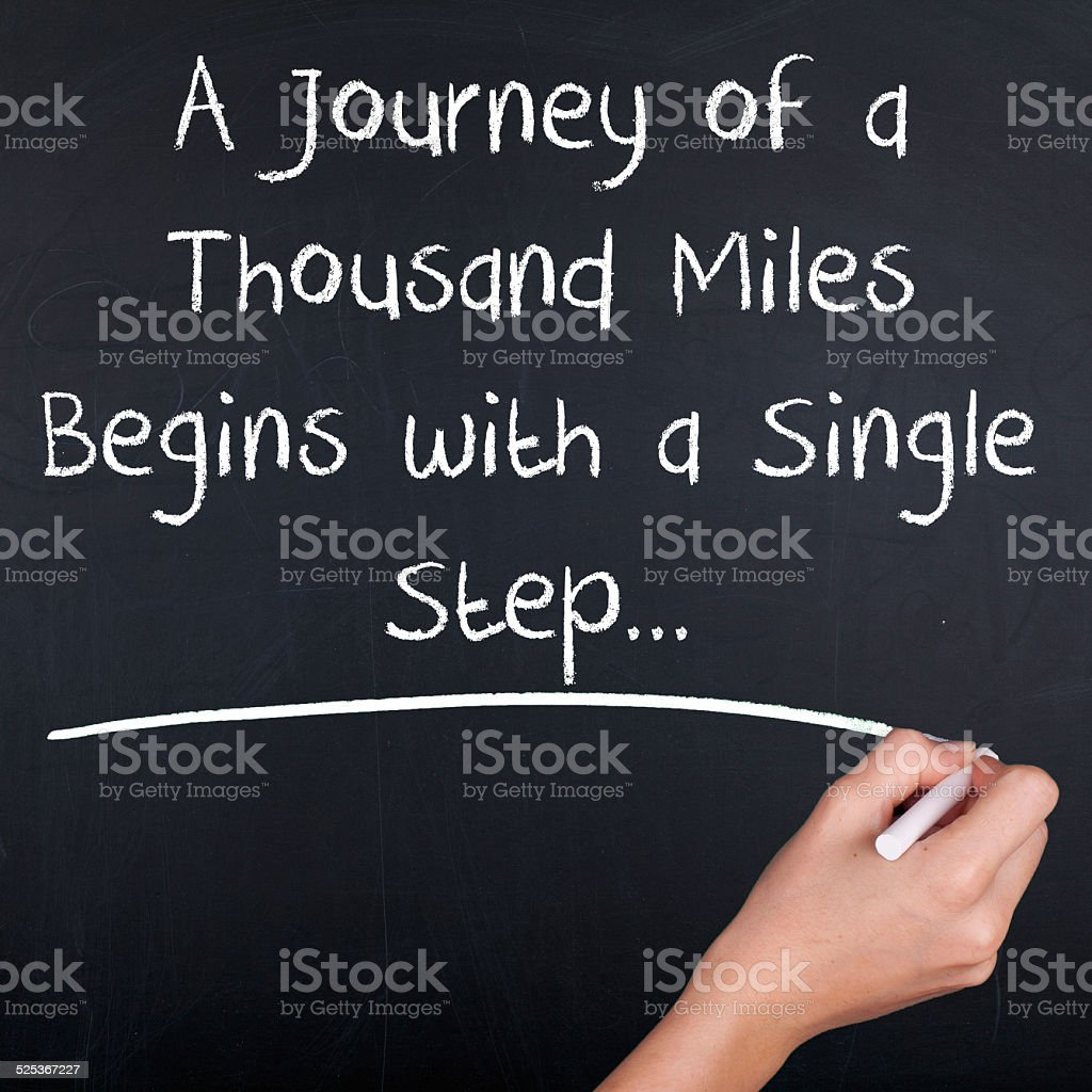 Journey of a thousand miles begins with a single step stock photo