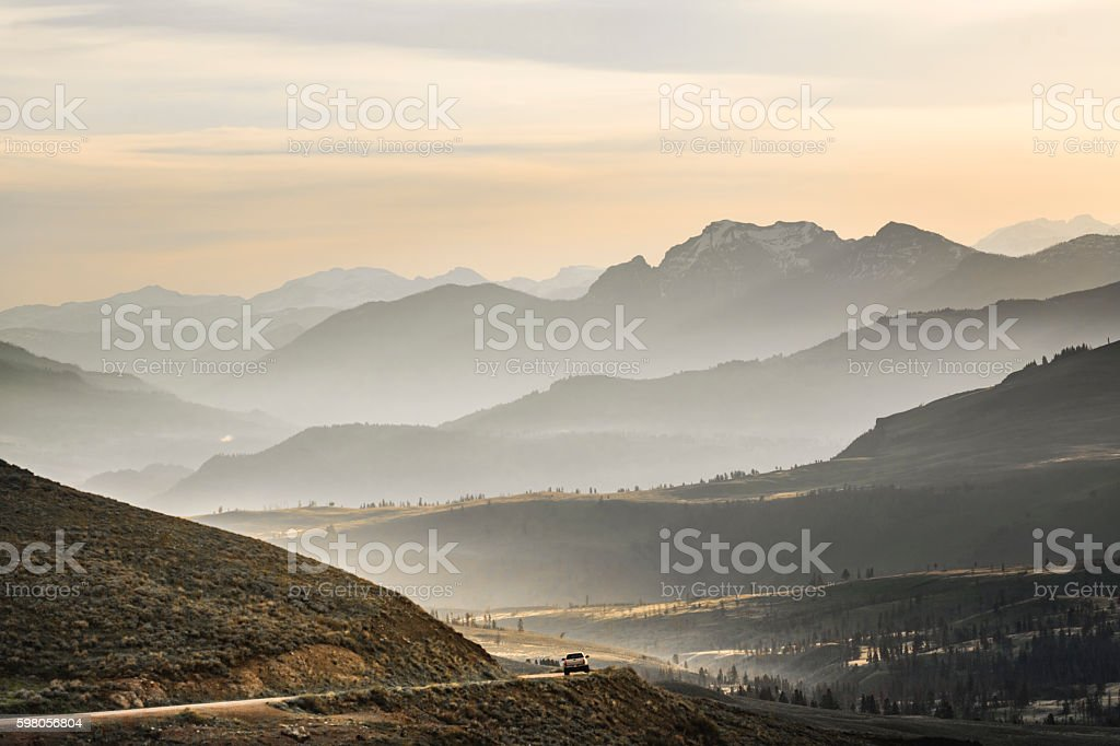 Journey through the mountains range with car pickup truck stock photo