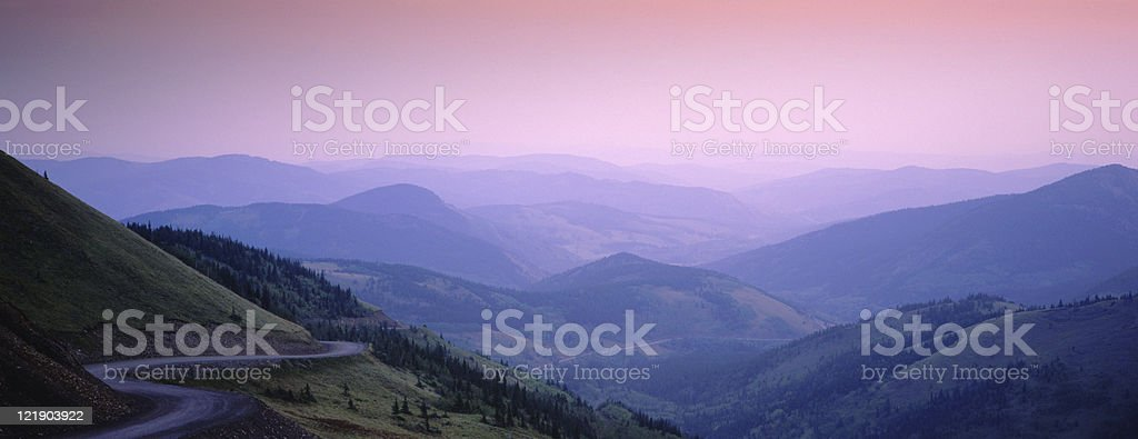 Journey through Winding Road in the Mountains royalty-free stock photo