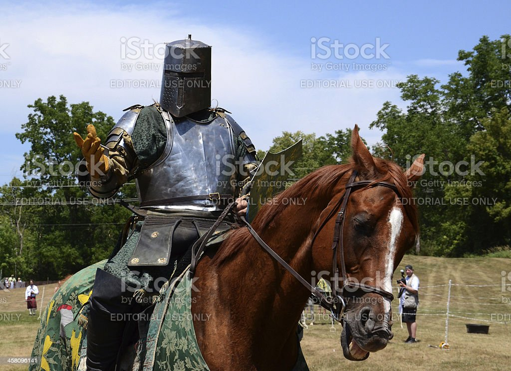 Jouster requesting his sword royalty-free stock photo