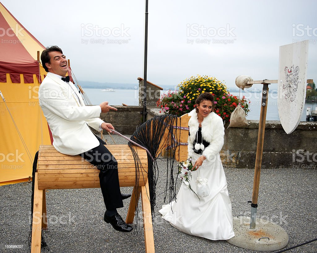Jousting Groom And Bride royalty-free stock photo