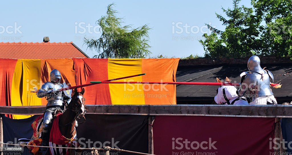Jousting Knights seconds before impact. royalty-free stock photo