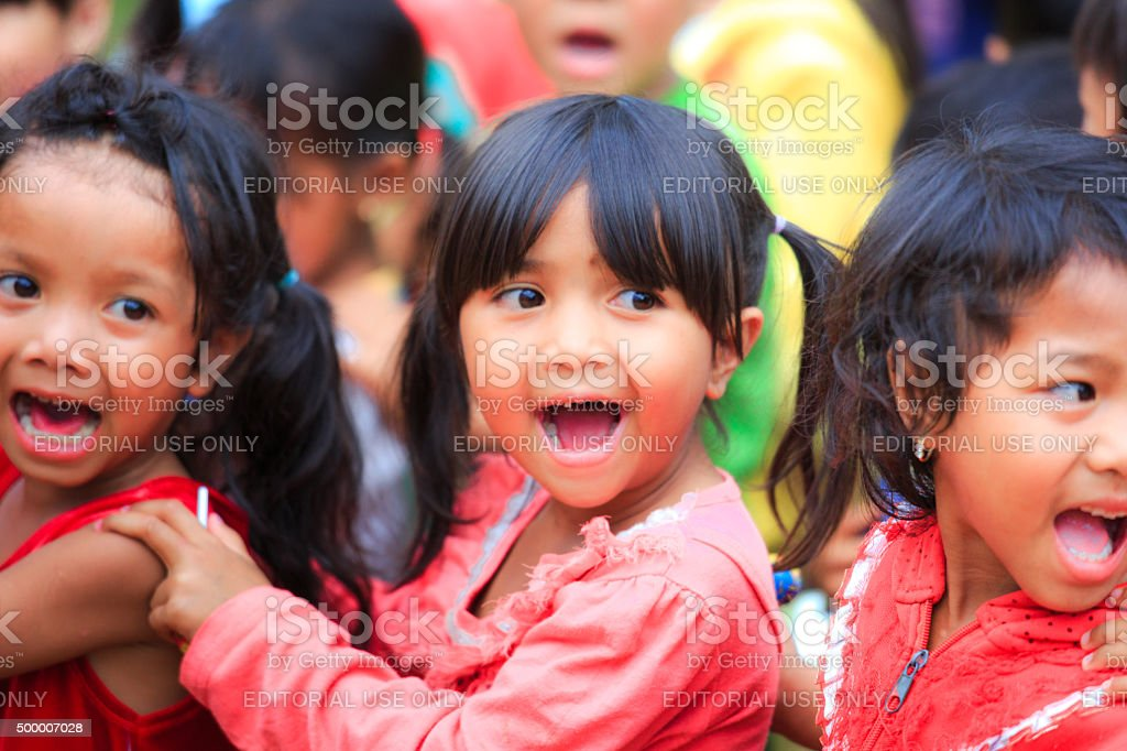 joy after receiving the gift of ethnic minority children stock photo
