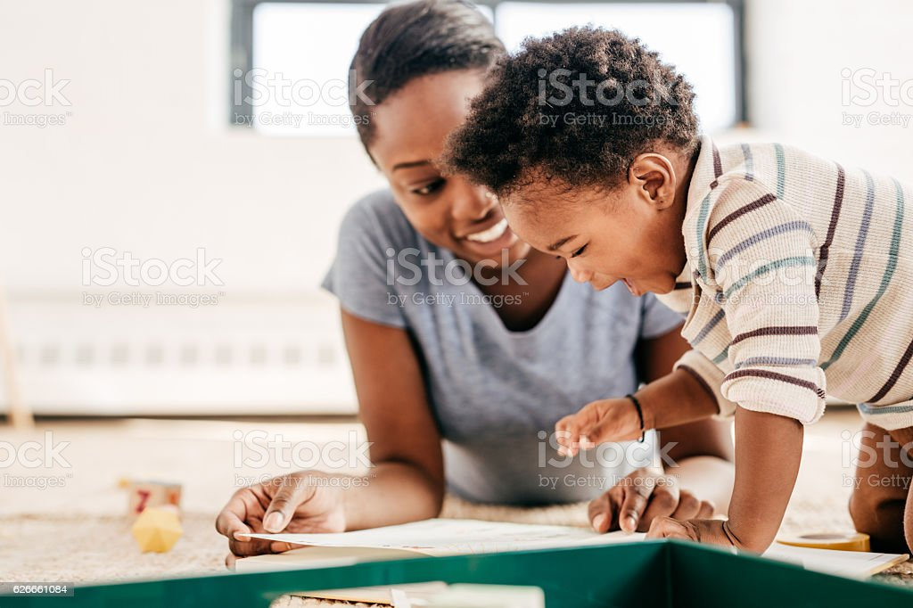 Joy of reading for toddler stock photo
