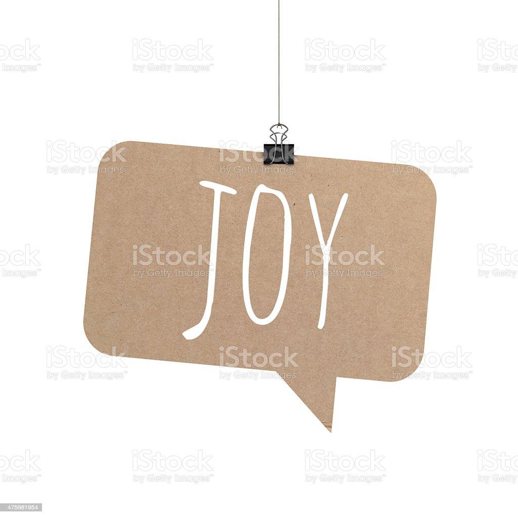 Joy speech bubble hanging on a string stock photo