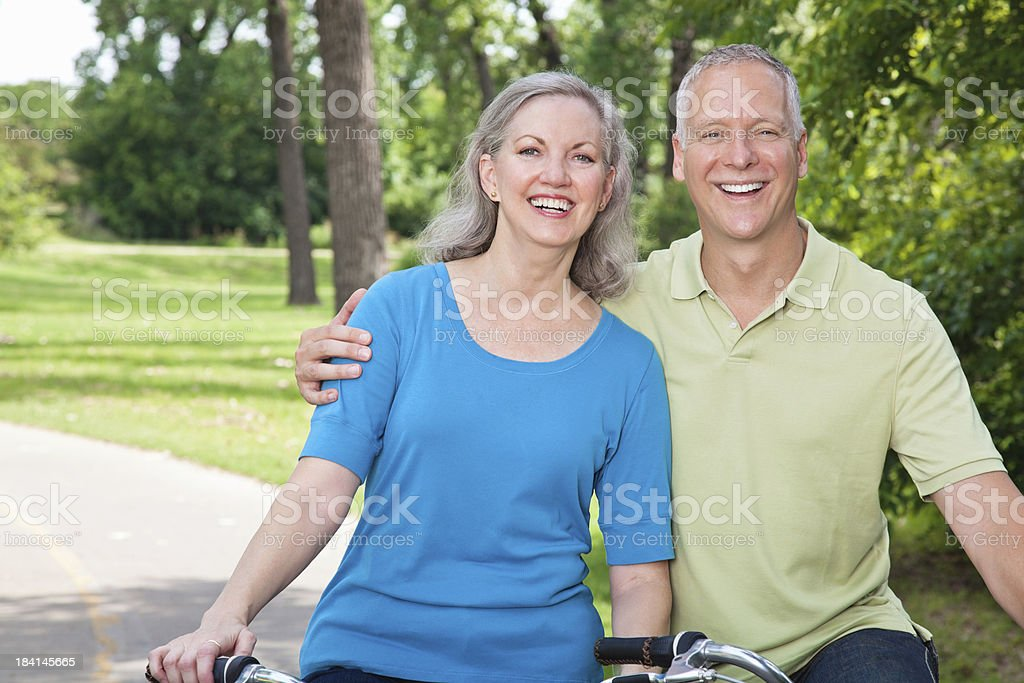 Joyful and Close Couple on Bikes with Copy Space royalty-free stock photo