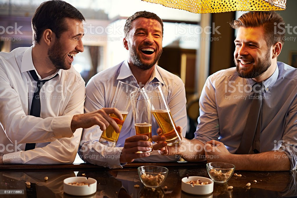 Joyful beer buddies stock photo
