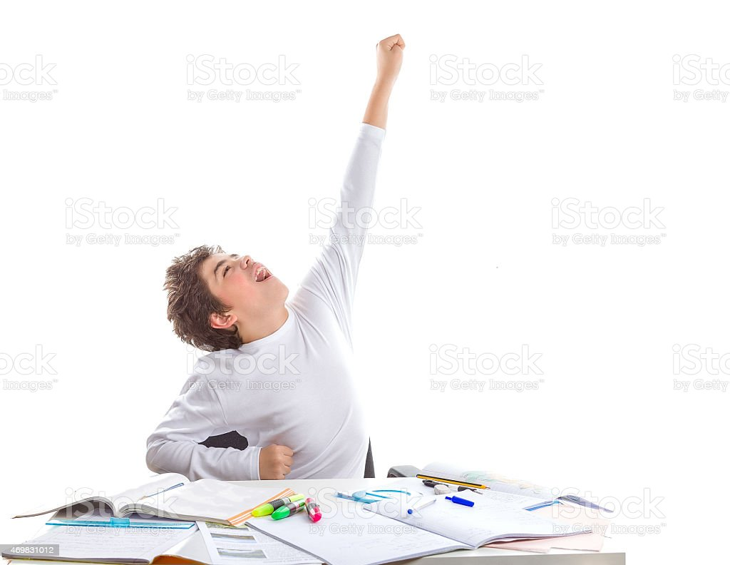 Joyful boy going to fly as superhero on blank books stock photo