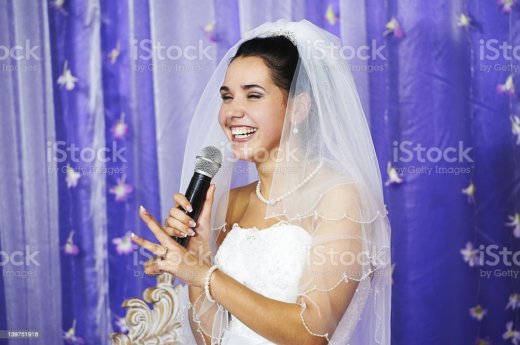 Joyful bride speaks at banquet royalty-free stock photo