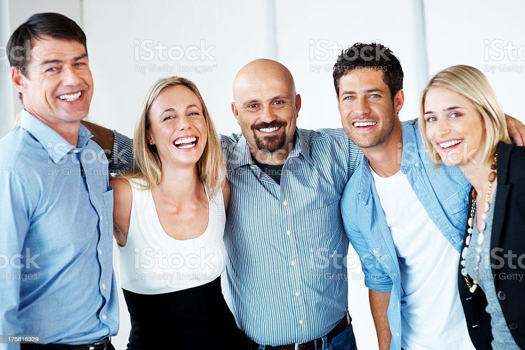 Joyful business team standing together stock photo