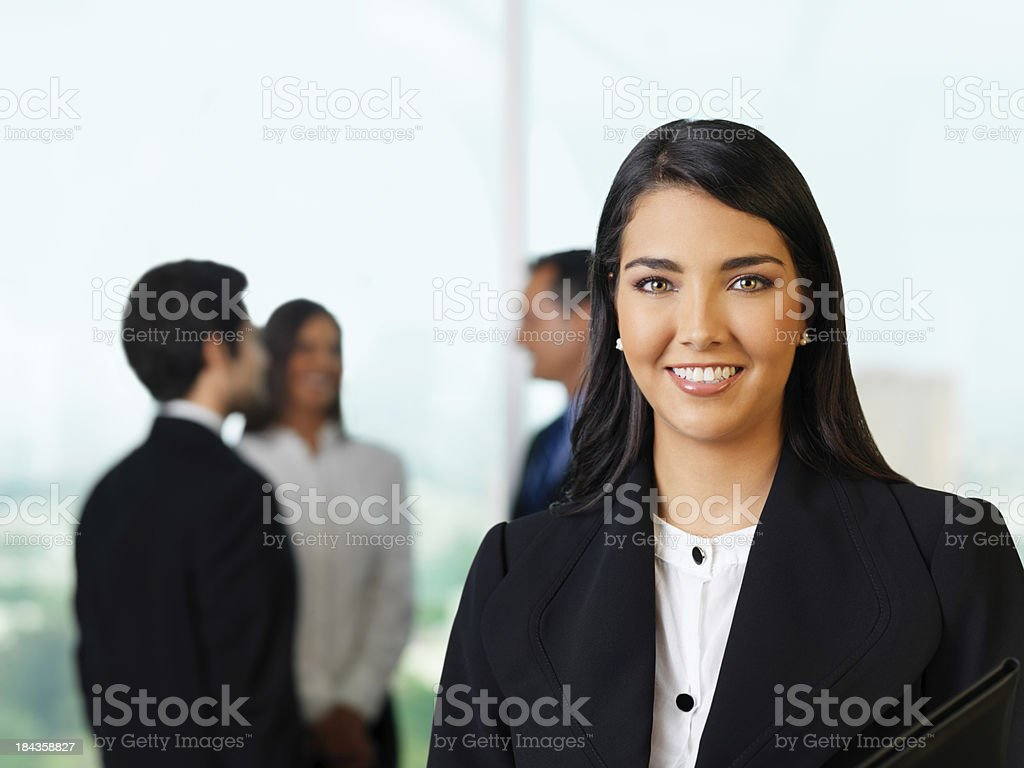 Joyful business woman and her team royalty-free stock photo