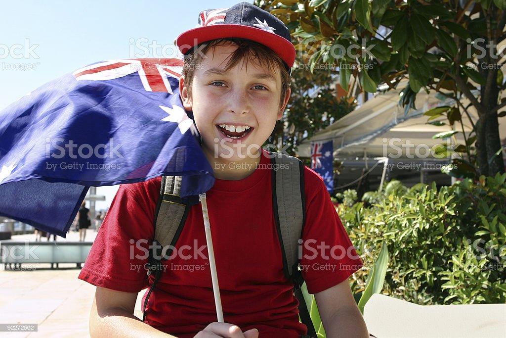 Joyful child flying flag stock photo
