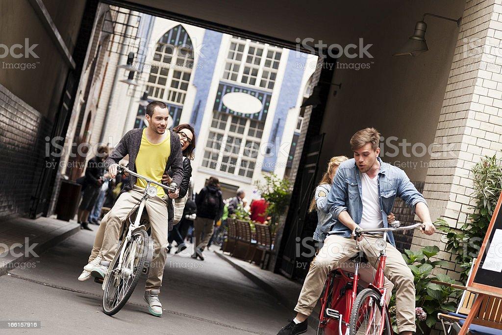 Joyful Couples Bicycle Ride royalty-free stock photo