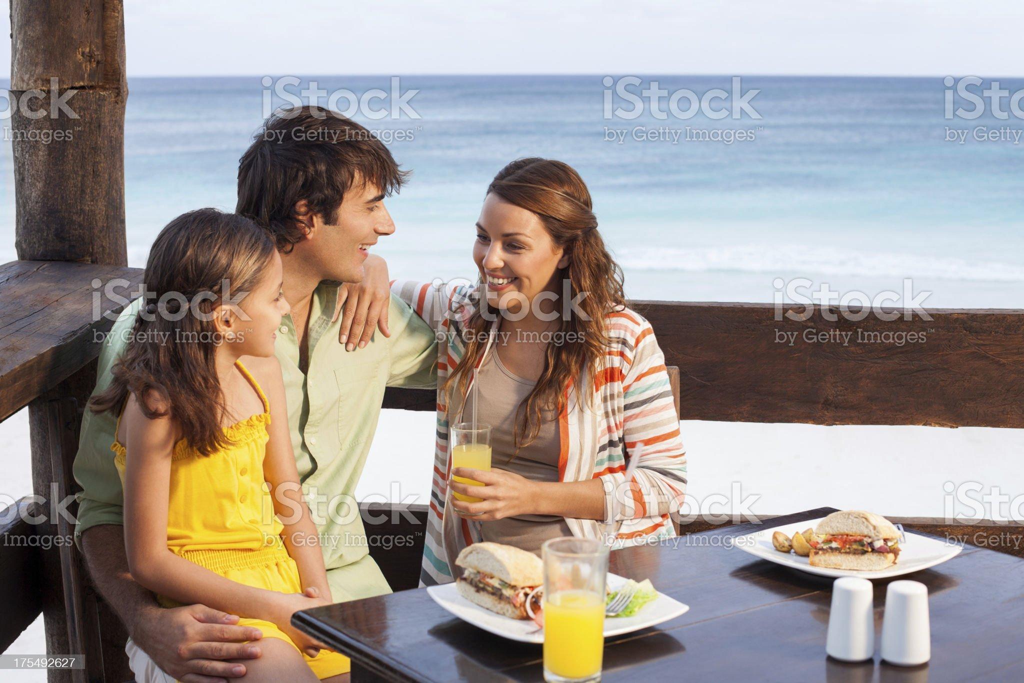 Joyful family eating together royalty-free stock photo