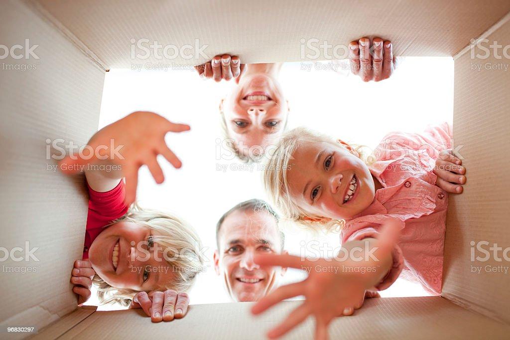 Joyful family unpacking boxes royalty-free stock photo