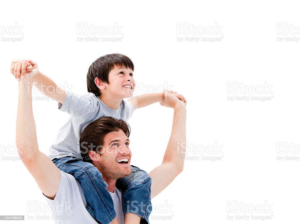 Joyful father giving piggyback ride to his son stock photo