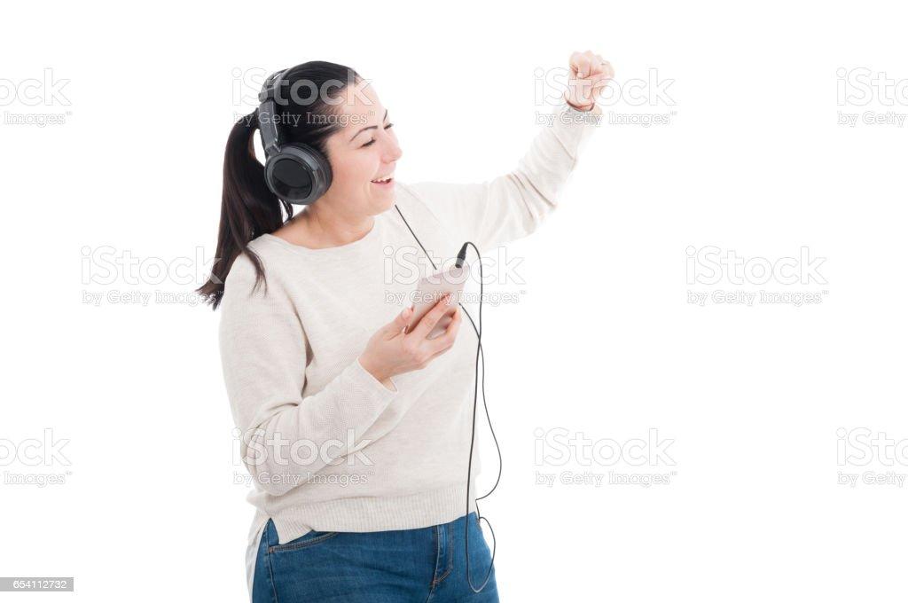 Joyful female listening music and dancing stock photo