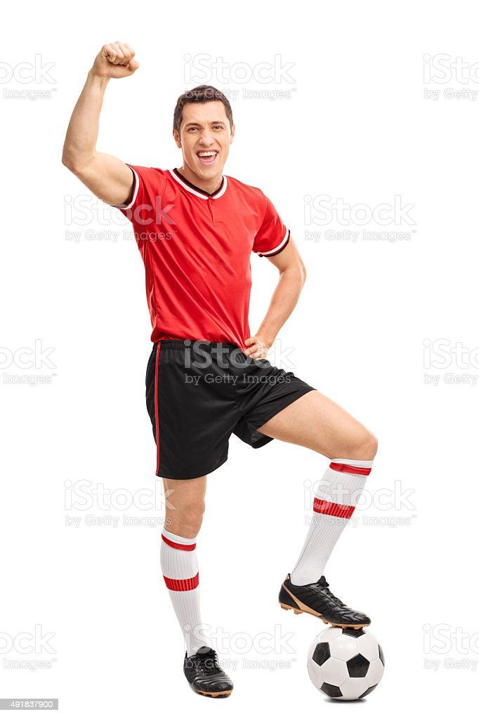 Joyful football player gesturing happiness stock photo
