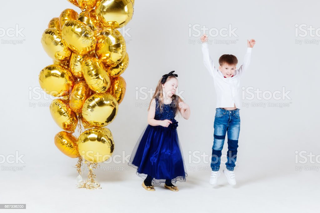 Joyful Girl and boy with balloons stock photo