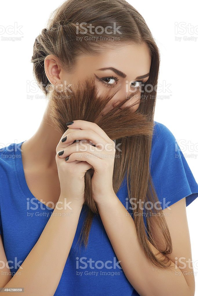 Joyful girl playing with hair stock photo