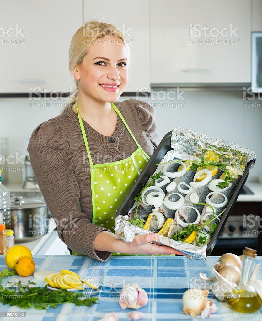 Joyful girl with raw fish stock photo
