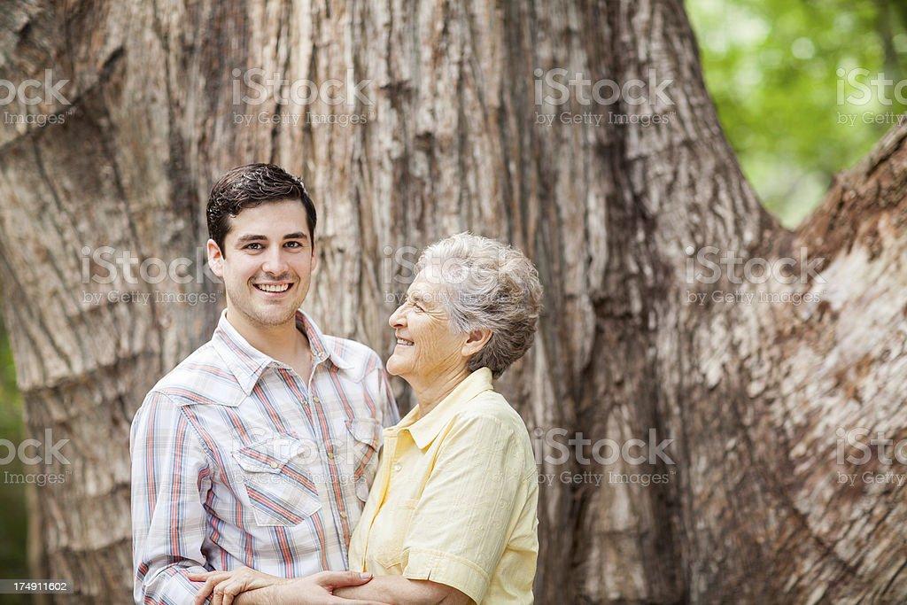 Joyful grandson hugging his grandmother royalty-free stock photo