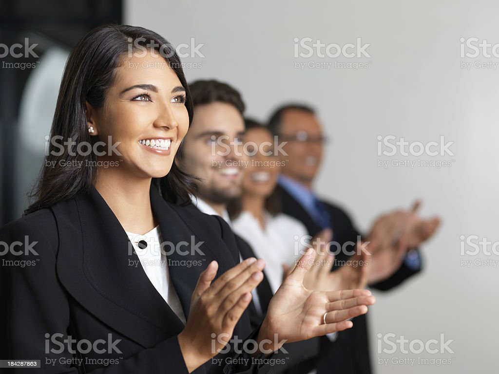 Joyful group of business people clapping royalty-free stock photo