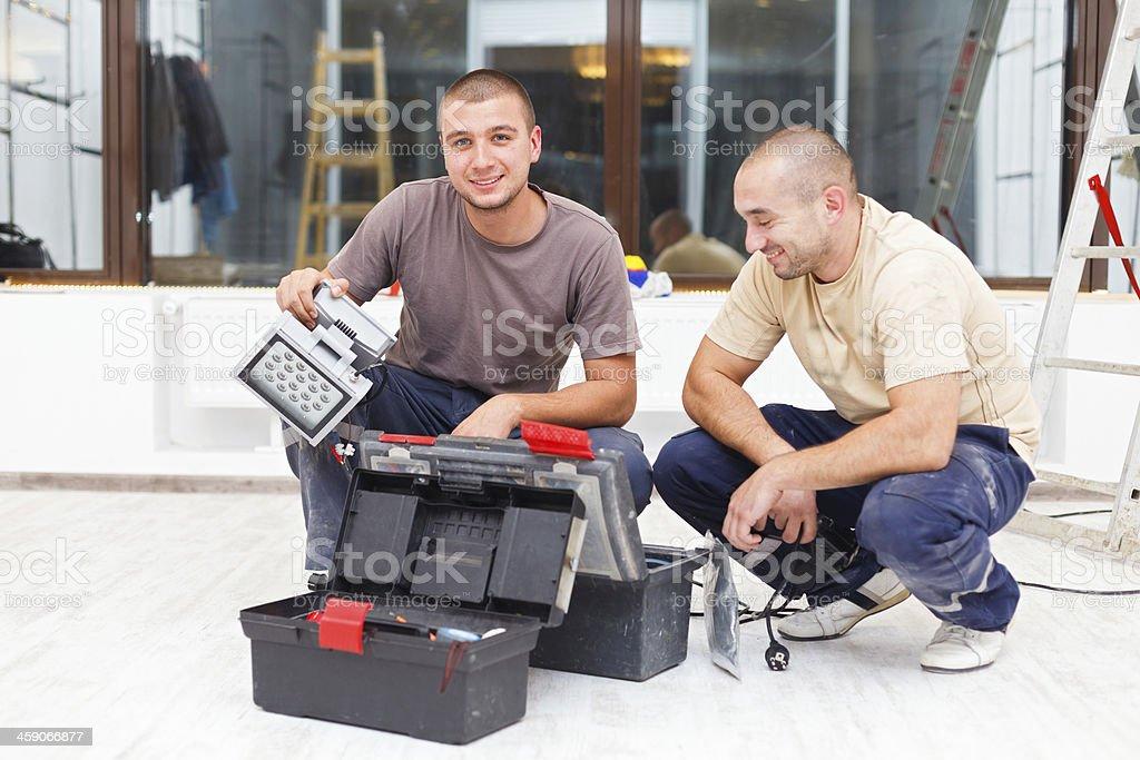 Joyful Handy Men and Their Tool Boxes royalty-free stock photo