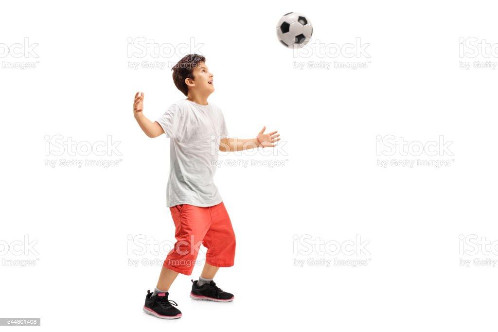 Joyful kid playing football stock photo