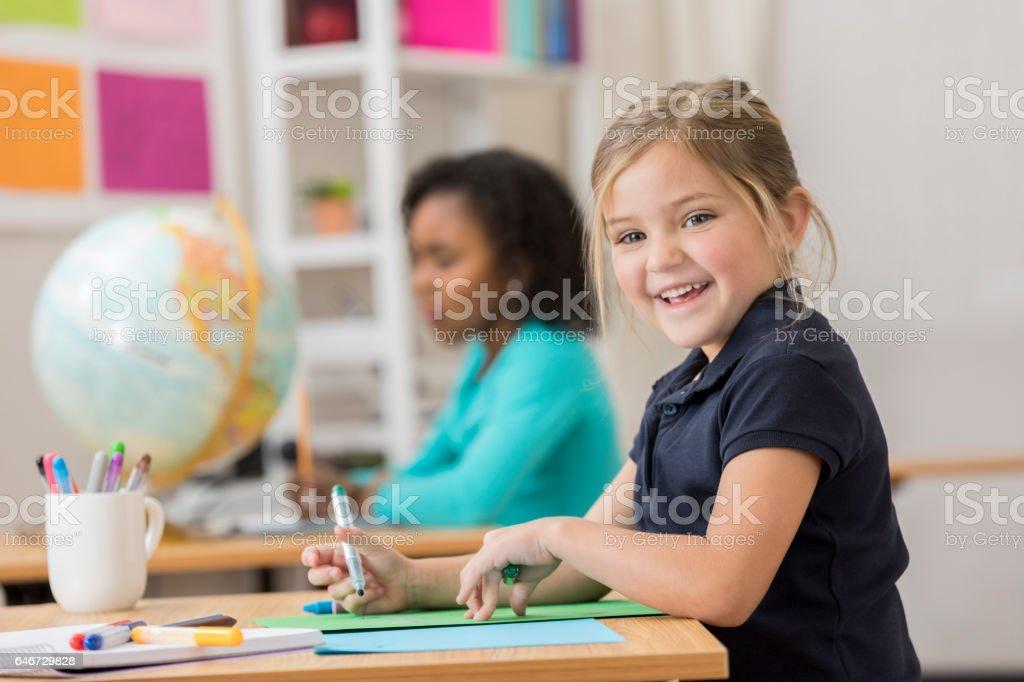 Joyful little girl at school stock photo